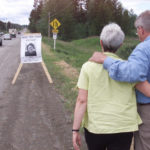 Jack and Barb Hoar of Red Deer, AB, walking to the last known site where their 25 year old daughter Nicole Hoar