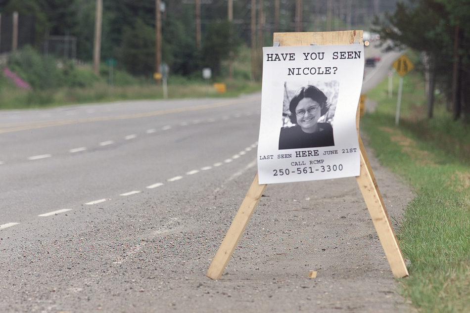 A sign of 25-year-old Nicole Hoar of Red Deer, AB, where she was last seen while hitchhiking along Yellowhead 16 Hwy by the Gauthier Road intersection during a trip from Prince George to Smithers, B.C., June 21, 2002