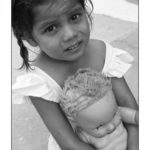 a orphanage girl with her doll