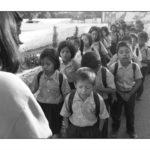 Children lining up for school